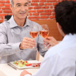 Senior mtoasting with someone younger — Stock Photo #8062699