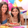 Portrait of mother and daughter at birthday party — Stock Photo