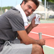 Tennis player sat on bench — Stock Photo