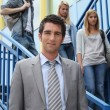 Teacher and students on the steps — Stock Photo #8063164