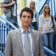 Teacher and students on the steps — Stock Photo