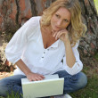 Woman using laptop in park — Stock Photo #8063200