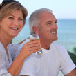 Couple drinking beer in beach terrace — Stock Photo #8063215