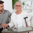 Elderly person looking at photos with son — Foto de Stock