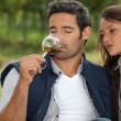 Couple tasting wine in field — Stock Photo #8063429
