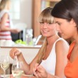 Girlfriends having lunch at home — Stock Photo #8063442