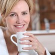 Wife having a cup of tea — Stock Photo #8063476