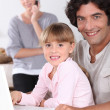 Dad and daughter using a laptop — Stock Photo