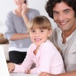 Stock Photo: Dad and daughter using a laptop
