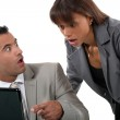 Office workers shocked in front of a computer — Stock Photo