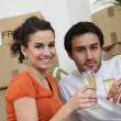 Couple celebrating purchase of first house together — Stock Photo