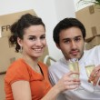 Couple celebrating purchase of first house together - Stock Photo