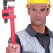 Stock Photo: Mwith heavy duty adjustable pipe wrench