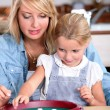 Mother and daughter playing a game — Stock Photo #8064716