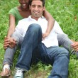 Portrait of a couple on the grass — Stok fotoğraf