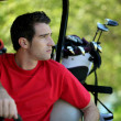 Golfer in buggy. — Stock Photo #8065062