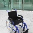 Empty wheelchair outside office building — Foto de Stock