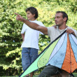 Royalty-Free Stock Photo: Father and son flying kite