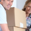 Couple carrying boxes — Stock Photo #8065733