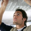 Man putting up a suspended ceiling — Stock Photo #8065972