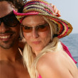 Couple wearing sunglasses at the beach — Stock Photo