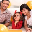 Young family at Halloween — Stock Photo