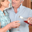 Middle-aged couple with wine — Stock Photo