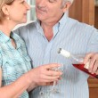 Middle-aged couple with wine — Stock Photo #8066213