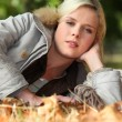 Stock Photo: Womlying on autumnal forest floor