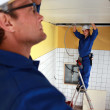 Electrical team wiring a tiled room — Stock Photo