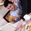 Happy young couple at breakfast — Stock Photo