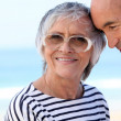 Elderly couple at the beach together — Stock Photo #8068043