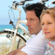 Couple with bicycles by coast — Stock Photo #8068146