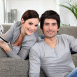 Foto Stock: Couple relaxing in their living room