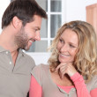 Foto Stock: Couple flirting in kitchen