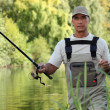 Man fishing in river — Stock Photo