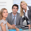 Stock Photo: Three colleagues in office