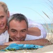 Couple relaxing at the seaside — Stock Photo #8068860