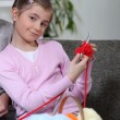 Girl knitting — Stock Photo #8068942