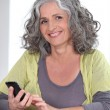 Older woman using a cellphone — Stock Photo