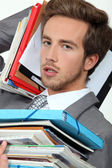 Male office worker under pressure — Stock Photo
