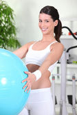 Young woman using an exercise ball — Stock Photo