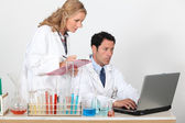 Laboratory workers and equipment — Stock Photo