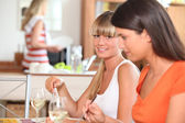 Girlfriends having lunch at home — Stock Photo