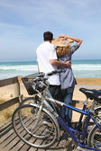 Couple with bikes by the sea — Stock Photo