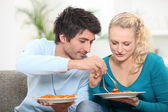 Young couple having dinner at home — Stock Photo