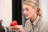 Female technician working on an electronic circuit — Stock Photo