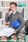 An annoyed architect talking on the phone — Stock Photo