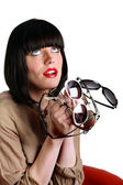 Woman holding several pairs of sunglasses — Stock Photo