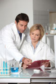 A man and a woman working in a lab. — Stock Photo